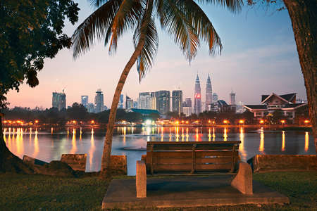 Photo for Beautiful morning in public park in Kuala Lumpur. Skyline of the modern city at sunrise. - Royalty Free Image