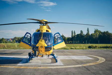 Foto de Helicopter of Emergency Medical Service prepared on heliport. Themes rescue, help and hope. - Imagen libre de derechos