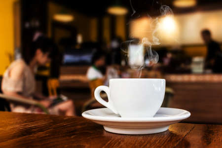 Foto de cup of coffee on table in cafe  - Imagen libre de derechos