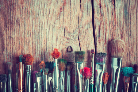 Photo for row of artist paintbrushes closeup on old wooden rustic table, retro stylized - Royalty Free Image