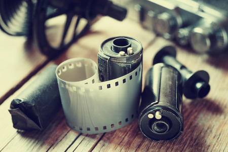 Photo for Old photo film rolls, cassette and retro camera. Vintage stylized. - Royalty Free Image