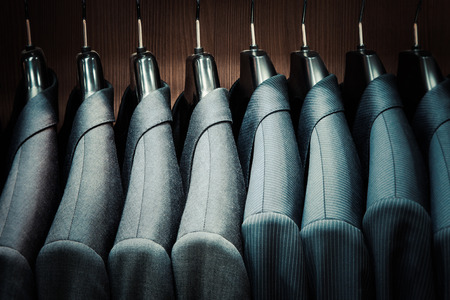 Photo for Row of men suit jackets on hangers - Royalty Free Image