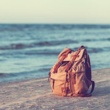 Foto de Travel Backpack on Summer Sea Beach. - Imagen libre de derechos