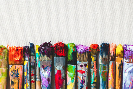 Photo for Row of artist paintbrushes closeup on artistic canvas. - Royalty Free Image