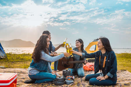 Photo pour Diversity women party clink bottles enjoy camping,trekking,travel in vacation time relax. - image libre de droit