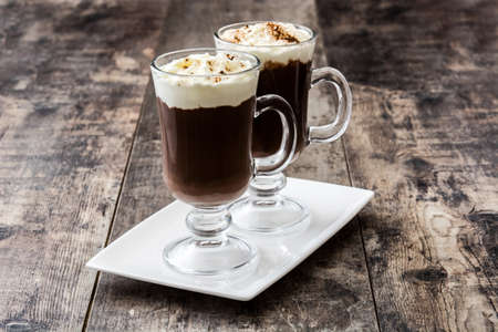 Photo for Irish coffee in glass on wooden background - Royalty Free Image