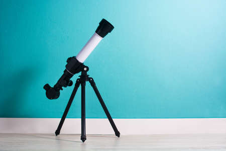 Photo pour Telescope in a boy's room copyspace - image libre de droit