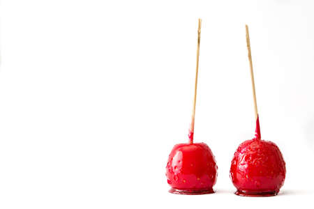Foto de Candy Christmas apples isolated on white background.Copyspace - Imagen libre de derechos
