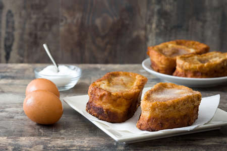 Photo for Traditional homemade Spanish torrijas on wooden background. Easter dessert - Royalty Free Image