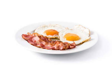 Foto per Fried eggs and bacon for breakfast isolated on white background. - Immagine Royalty Free