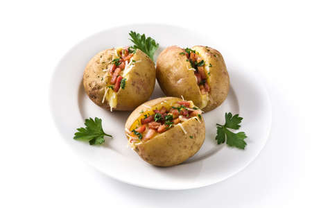 Foto de Stuffed potatoes with bacon and cheese on plate isolated on white background - Imagen libre de derechos