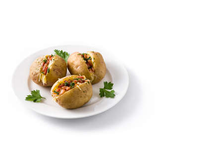 Foto de Stuffed potatoes with bacon and cheese on plate isolated on white background. Copyspace - Imagen libre de derechos