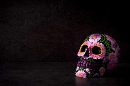 Photo pour Typical Mexican skull painted on black background.Copyspace. Dia de los muertos. - image libre de droit