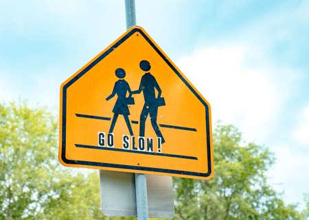 Foto de School crossing sign with go slow lettering - Imagen libre de derechos