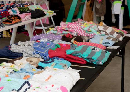 Foto de Colorful children's pajamas a suburban yard sale - Imagen libre de derechos