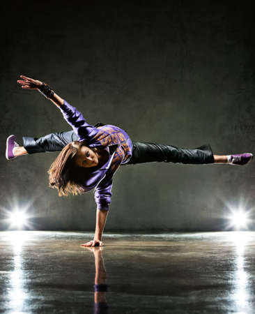 Foto de Young woman dancer. On wall background. - Imagen libre de derechos