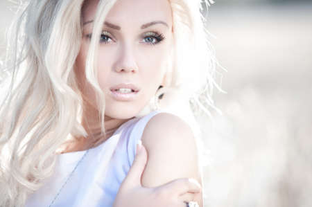 Young woman outdoors portrait. Bright white colors.