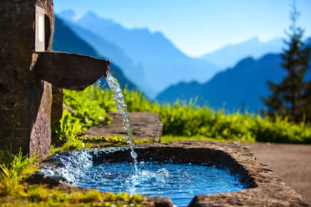 Photo for Water spring on Alps mountains background. - Royalty Free Image