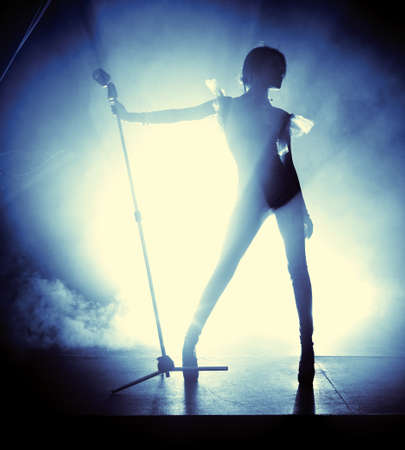 Photo for Young woman singer. Contrast silhouette. - Royalty Free Image