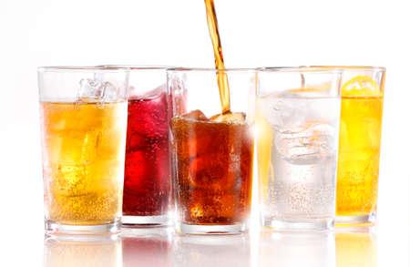 Foto de Soft drinks with ice being poured - Imagen libre de derechos