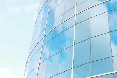 Foto de background of blue sky reflect on glasses from modern business building - Imagen libre de derechos