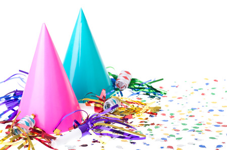Foto de Two colorful birthday party hats with noisemakers and confetti on a white background - Imagen libre de derechos