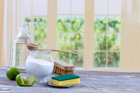 Photo for Eco-friendly natural cleaners baking soda, lemon and cloth on wooden table kitchen background, - Royalty Free Image