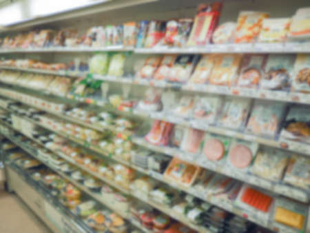 many food and snack at shelf in convenience store japan on blur background