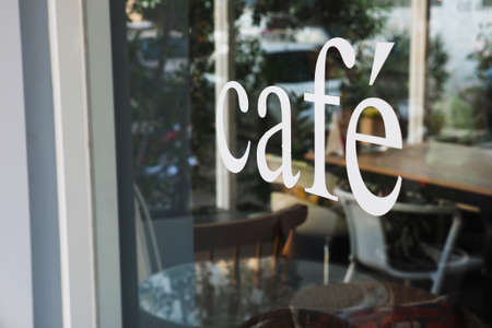 Photo for text cafe in front of mirror coffee shop - Royalty Free Image