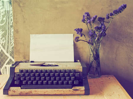 Photo for vintage typewriter on the wood texture background with vintage color tone - Royalty Free Image