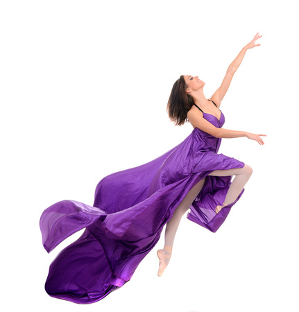 Photo for jumping girl dancer in flying purple dress isolated on white background - Royalty Free Image