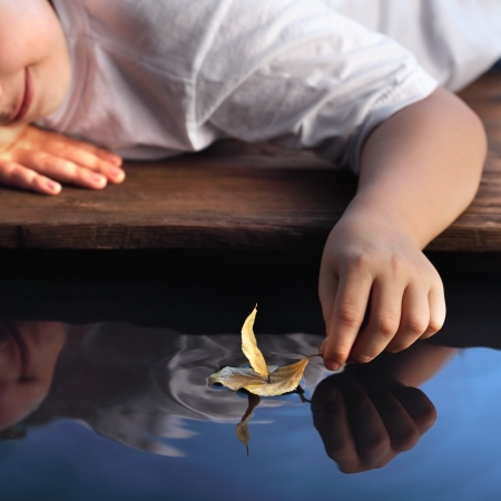 Photo for leaf ship in children hand, focus on hand - Royalty Free Image