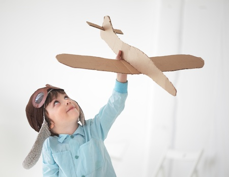 Foto de happy boy play in airplane  indoors - Imagen libre de derechos