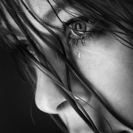 Foto de beauty girl cry on black background - Imagen libre de derechos