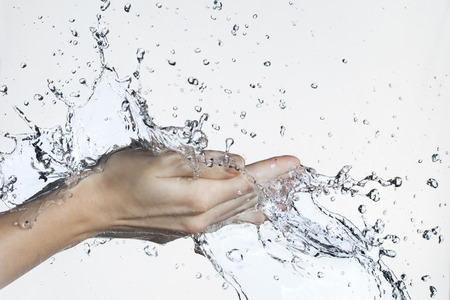 Photo for Splash of Water in Woman Hand - Royalty Free Image