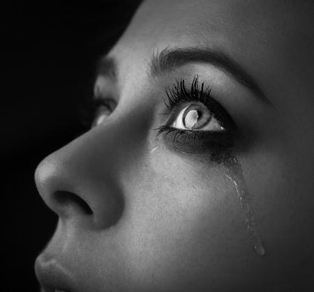 Foto de beauty girl cry on dark background monochrome black and white photo - Imagen libre de derechos