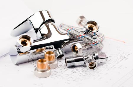 Foto de shower faucet, plumbing and draft for repair - Imagen libre de derechos