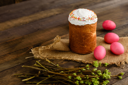 Photo for Easter cake and colorful eggs on a wooden table. It can be used as a background - Royalty Free Image