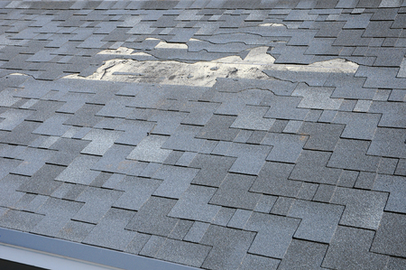 Photo for A close up view of shingles a roof damage. Roof Shingles - Roofing. - Royalty Free Image