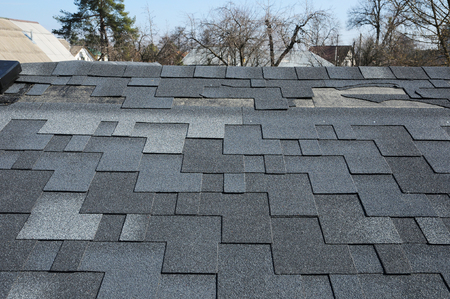 Photo pour A close up view of shingles a roof damage. Roof Shingles - Roofing. - image libre de droit