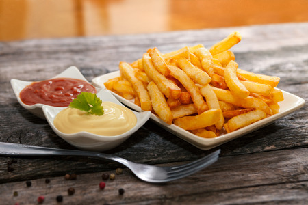 Photo pour French fries with mayonnaise and tomato sauce for snack - image libre de droit