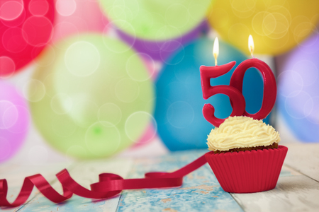 Photo pour Candle on top of birthday cupcake, celebration of fiftieth birthday - image libre de droit
