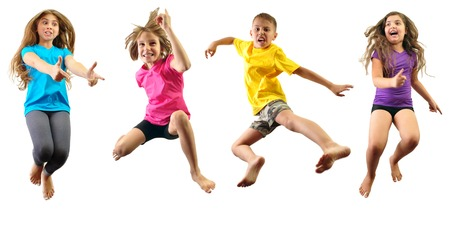 Photo pour Group of happy children jumping and having fun isolated over white. Childhood, happiness, active lifestyle concept - image libre de droit
