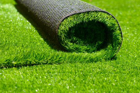Photo for artificial rolled green grass; closeup - Royalty Free Image
