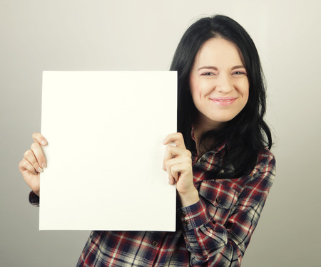 Photo for young casual woman happy holding blank sign - Royalty Free Image