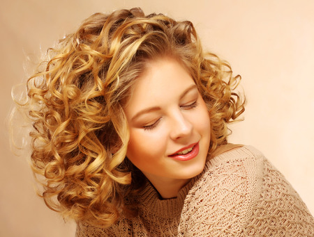 Photo for beautiful woman with curly hair - Royalty Free Image