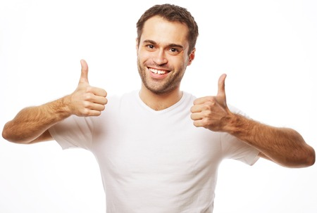 Photo for life style  and people concept: Happy handsome man wearing white t-shirt showing thumbs up over isolated background - Royalty Free Image