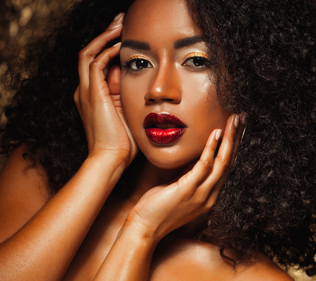 Photo for young elegant african american woman with afro hair. Glamour makeup. Golden Background. - Royalty Free Image