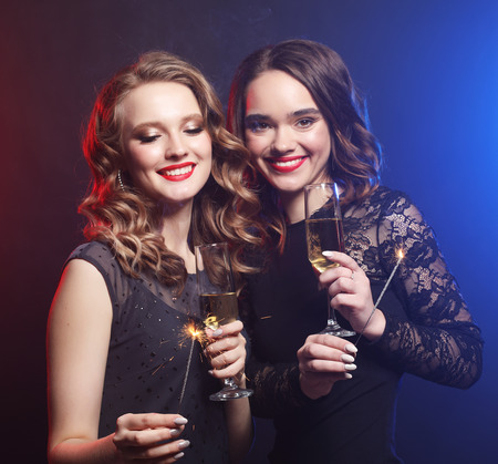 Photo for Party time. Two beautiful young women with wine glasses - Royalty Free Image