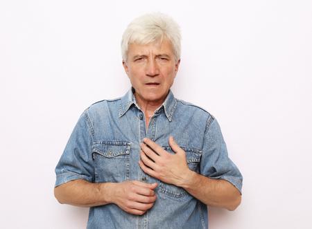 Photo pour Old man holding breast because of heart infarction - image libre de droit